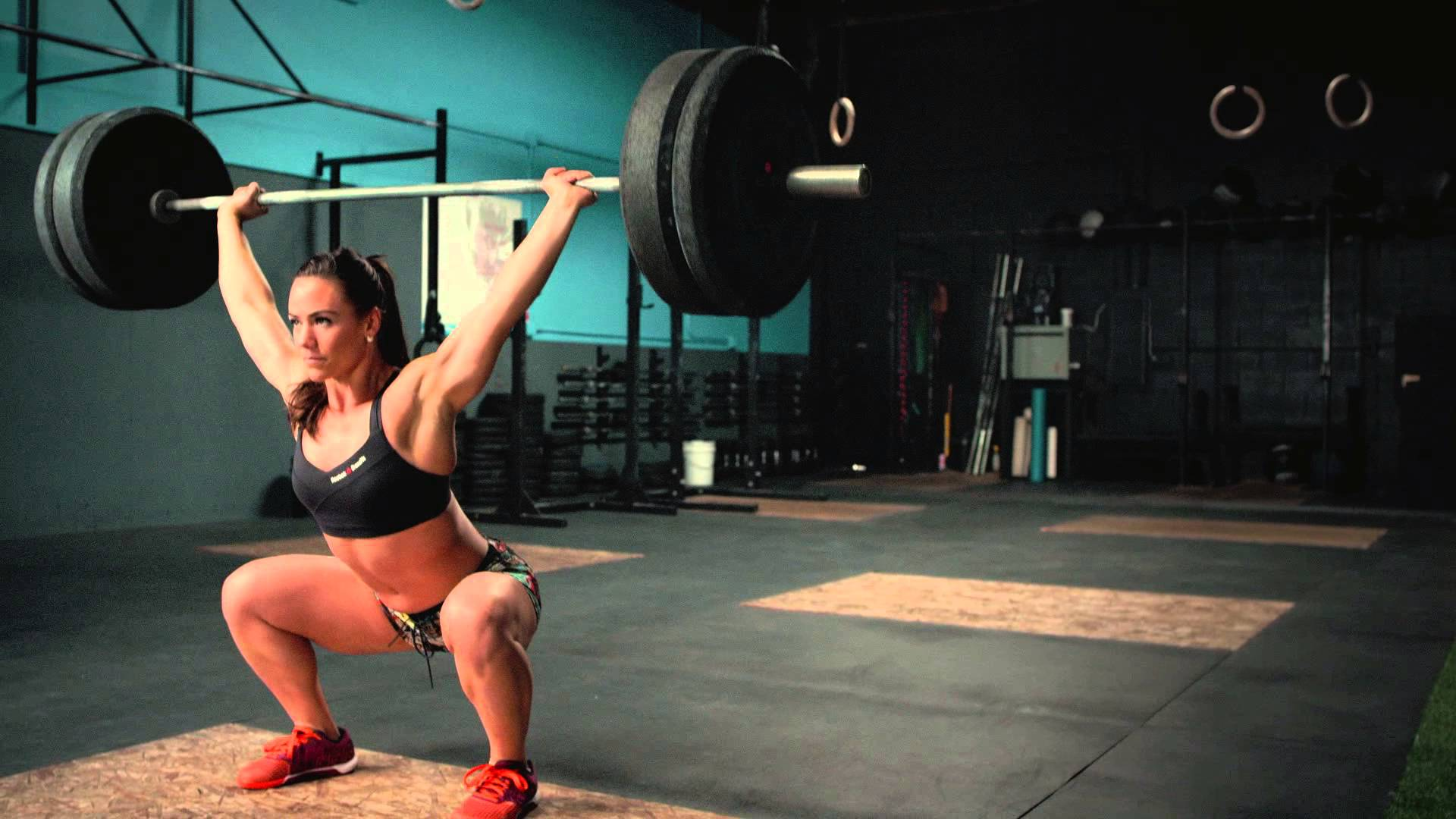 Woman Lifting Barbell Snatch